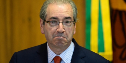 The president of the Brazilian Chamber of Deputies, Eduardo Cunha, gestures during breakfast with journalists in Brasília, on December 29, 2015. Cunha is a key figure in the impeachment process launched against President Dilma Rousseff.  AFP PHOTO / ANDRESSA ANHOLETE / AFP / Andressa Anholete        (Photo credit should read ANDRESSA ANHOLETE/AFP/Getty Images)