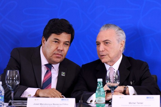 Brazilian acting President Michel Temer (R) speaks with his Education Minister Jose Mendonca Filho during a meeting with the Business Leaders Mobilization for Innovation Committee at the National Industry Confederation building in Brasilia on July 8, 2016. / AFP / EVARISTO SA        (Photo credit should read EVARISTO SA/AFP/Getty Images)