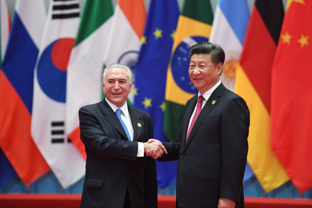 Brazil's President Michel Temer shakes hands with China's President Xi Jinping (R) before the G20 leaders' family photo in Hangzhou on September 4, 2016.World leaders are gathering in Hangzhou for the 11th G20 Leaders Summit from September 4 to 5. / AFP / Greg BAKER (Photo credit should read GREG BAKER/AFP/Getty Images)