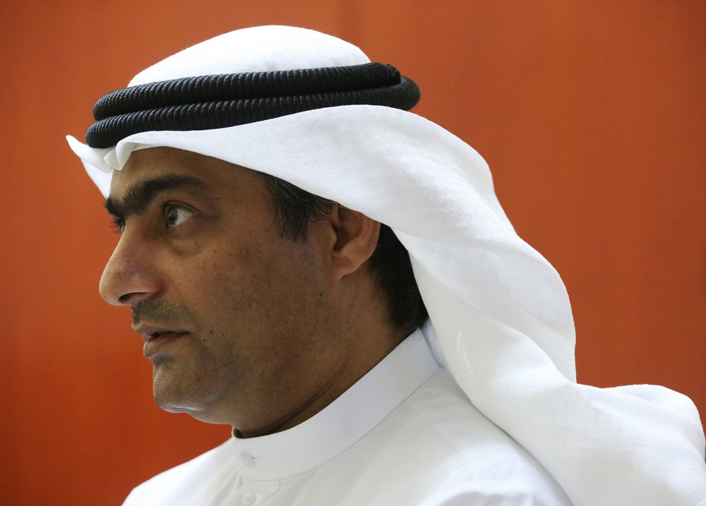 Human rights activist Ahmed Mansoor speaks to Associated Press journalists in Ajman, United Arab Emirates, on Thursday, Aug. 25, 2016. Mansoor was recently targeted by spyware that can hack into Apple's iPhone handset. The company said Thursday it has updated its security. (AP Photo/Jon Gambrell)