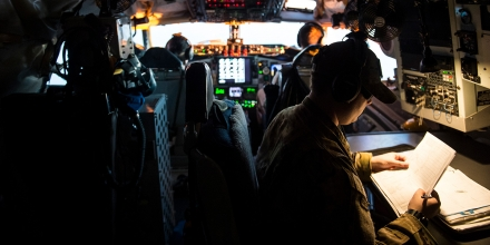 U.S. Air Force Senior Airman Ryan Thayer looks over flight paperwork while flying on a KC-135 Stratotanker over Iraq, March 17, 2016, in support of Operation Inherent Resolve. Thayer is a boom operator deployed out of the 344th Air Refueling Squadron at McConnell Air Force Base, Kan. (U.S. Air Force photo by Staff Sgt. Corey Hook/Released)