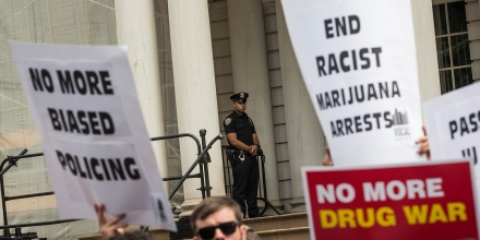 NEW YORK, NY - JULY 09:  A police officer on the steps of New York City Hall monitors a protest in support of the proposed Fairness and Equity Act, which would attempt to reform racially biased arrests in regards to marijuana possession in New York state on July 9, 2014 in New York City.  New York State recently passed a new law allowing medical marijuana usage.  (Photo by Andrew Burton/Getty Images)