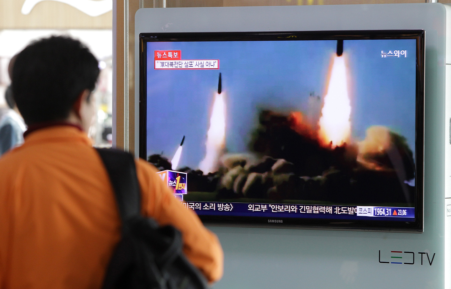 SEOUL, SOUTH KOREA - MARCH 26:  A Man watchs a television broadcast reporting the North Korean missile launch at the Seoul Railway Station on March 26, 2014 in Seoul, South Korea. North Korea test-launched two Nodong medium-range ballistic missiles into the sea off Korean peninsula's east coast on Wednesday morning, according to South Korea's defence ministry.  (Photo by Chung Sung-Jun/Getty Images)