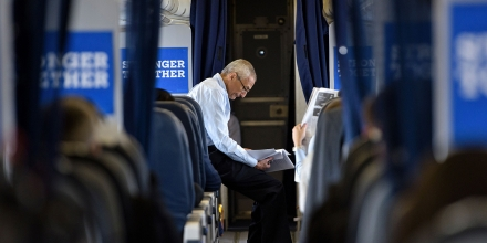John Podesta, Clinton Campaign Chairman, reads over notes on board Democratic presidential nominee Hillary Clinton's plane at Westchester County Airport September 27, 2016 in White Plains, New York, before traveling with Clinton to Raleigh, North Carolina. / AFP / Brendan Smialowski        (Photo credit should read BRENDAN SMIALOWSKI/AFP/Getty Images)
