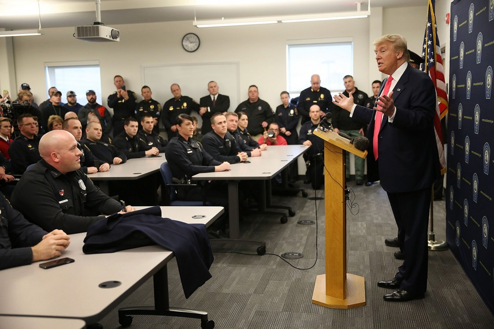 MANCHESTER, NH - FEBRUARY 04:  Republican presidential candidate Donald Trump speaks to officers while visiting the Manchester Police Department during a shift change on February 4, 2016 in Manchester, New Hampshire. Democratic and Republican Presidential candidates are stumping for votes throughout New Hampshire leading up to the primary on February 9.  (Photo by Joe Raedle/Getty Images)