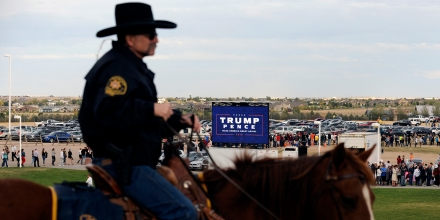 A mounted Larimer sheriff deputy watches as a capacity crowd of supporters of Republican Presidential nominee Donald Trump line up outside the Budweiser Events center in Loveland, Colorado on October 3, 2016. / AFP / Jason Connolly        (Photo credit should read JASON CONNOLLY/AFP/Getty Images)