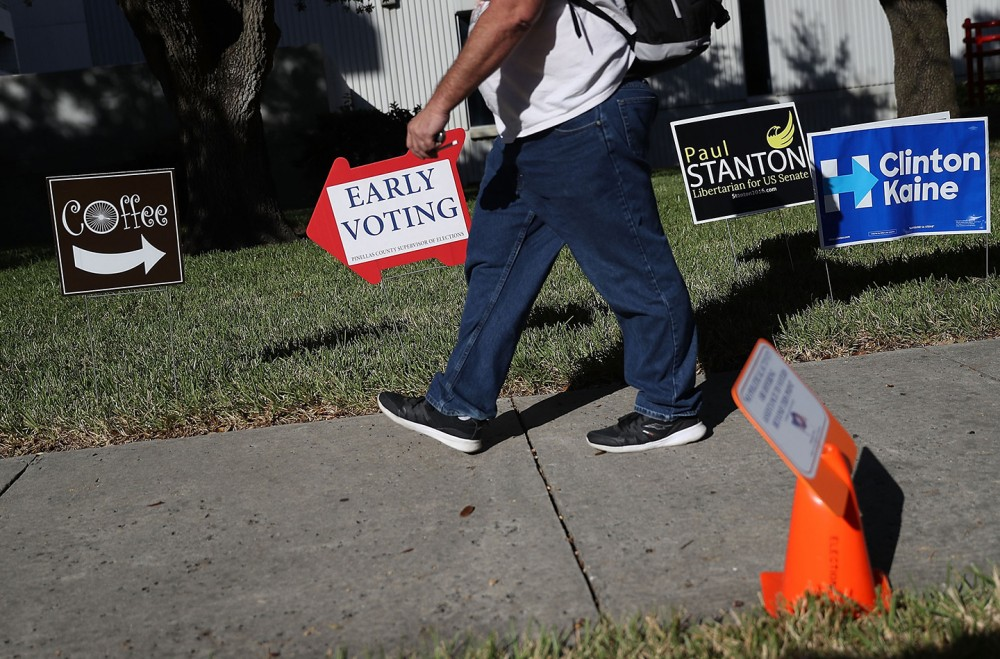 ST. PETERSBURG, FL - OCTOBER 24:  An early voting sign points voters to the polling station at the Pinellas County Election Services office on October 24, 2016 in St. Petersburg, Florida.  Today early general election voting started in the state of Florida and ends on either Nov 5 or Nov 6th.  (Photo by Joe Raedle/Getty Images)