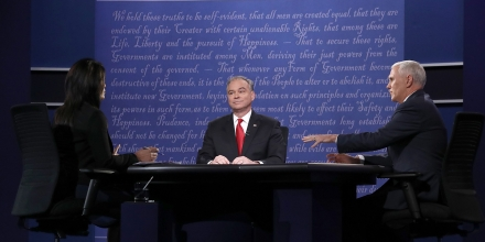 Democratic vice presidential nominee Tim Kaine (C) listens as Republican vice presidential nominee Mike Pence and debate moderator Elaine Quijano speak during the Vice Presidential Debate at Longwood University in Farmville, Virginia on October 4, 2016.