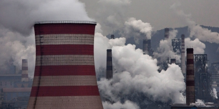 HEBEI, CHINA - NOVEMBER 19:  Smoke billows from smokestacks and a coal fired generator at a steel factory on November 19, 2015 in the industrial province of Hebei, China. China's government has set 2030 as a deadline for the country to reach its peak for emissions of carbon dioxide, what scientists and environmentalists cite as the primary cause of climate change. At an upcoming conference in Paris, the governments of 196 countries will meet to set targets on reducing carbon emissions in an attempt to forge a new global agreement on climate change.  (Photo by Kevin Frayer/Getty Images)