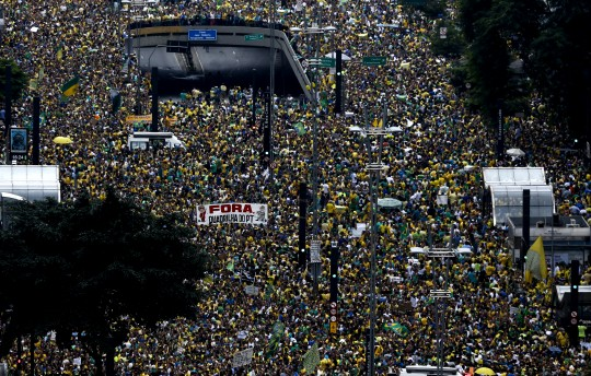 Thousands of demonstrators rally in support of the impeachment of Brazilian President Dilma Rousseff at Paulista Avenue in Sao Paulo, Brazil on March 13, 2016. Thousands of demonstrators clad in the yellow and green national flag's colors protested Sunday in several cities of Brazil to demand Rousseff's removal from office. AFP PHOTO-Miguel SCHINCARIOL / AFP / Miguel Schincariol        (Photo credit should read MIGUEL SCHINCARIOL/AFP/Getty Images)