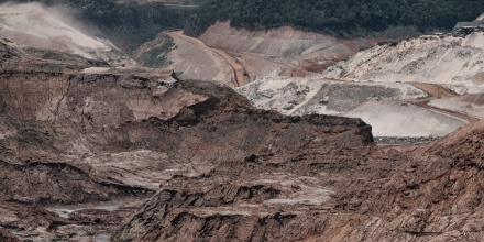 General view of the rebuilding site next to the collapsed iron ore waste dam of Brazilian mining company Samarco, in Mariana, Minas Gerais State, Brazil, on October 26, 2016.Next November 5 marks the first anniversary of the burst of the iron ore waste dam of Samarco -owned by BHP Billiton and Vale SA- which killed nineteen people and destroyed the ecosystem of the Doce River in the worst mining accident in Brazil's history. / AFP / YASUYOSHI CHIBA (Photo credit should read YASUYOSHI CHIBA/AFP/Getty Images)