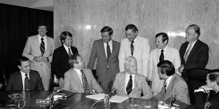 Three counsels to U.S. President Gerald Ford meet with members of the Select Senate Committee on Intelligence in Washington, D.C., June 26, 1975. They brought White House files with them to aid panel's investigation into where orders to assassinate Cuban Premier Fidel Castro originated. From left are: seated, James Wilderoffer, counsel; Roderick Hills, counsel; Philip Buchan, counsel; Sen. Frank Church (D-Idaho), chairman; and Sen. John Tower (R-Texas). Standing, Senators Gary Hart (D-Colorado), Robert Morgan (D-N.C.), Walter Mondale (D-Minn.), Richard Schweiker (R-Pa.), Howard Baker (R-Tenn.), and Charles McC. Mathias (R-Md). (AP Photo/Henry Griffin)