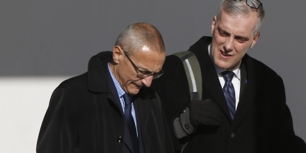 White House counselor John Podesta, left, walks with Chief of Staff Denis McDonough along the West Wing colonnade at the White House in Washington, Friday, Feb. 14, 2014, as they will accompany President Barack Obama to the Democratic House members retreat in Cambridge, Md. (AP Photo/Charles Dharapak)