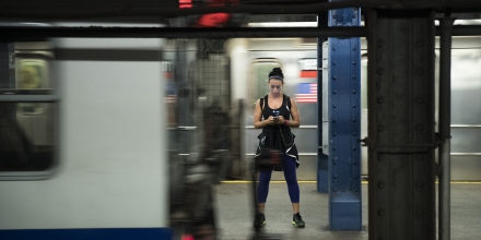 NEW YORK, NY - JULY 20: A woman looks at her smartphone as a train passes by at the 14th Street subway station, July 20, 2016 in New York City. The Metropolitan Transportation Authority (MTA) has placed digital signage in subway stations encouraging riders to be safe while playing the Pokemon Go app on their smartphones. (Photo by Drew Angerer/Getty Images)