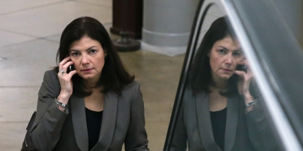WASHINGTON, DC - DECEMBER 12:  U.S. Sen. Kelly Ayotte (R-NH) talks on her phone as she rides an escalator at the US Capitol, on December 12, 2013 in Washington, DC. The Senate worked through the night debating U.S. President Barack Obama's Circuit Court nominations.  (Photo by Mark Wilson/Getty Images)