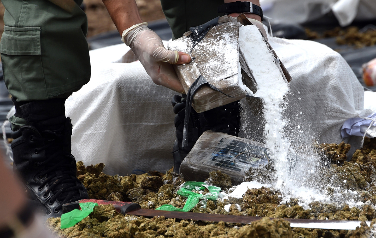 Panama's anti-narcotics personnel prepare to burn over 10 tons of cocaine and marijuana in Cerro Patacon, a dump near Panama City, on October 16, 2015. AFP PHOTO/ Rodrigo ARANGUA        (Photo credit should read RODRIGO ARANGUA/AFP/Getty Images)