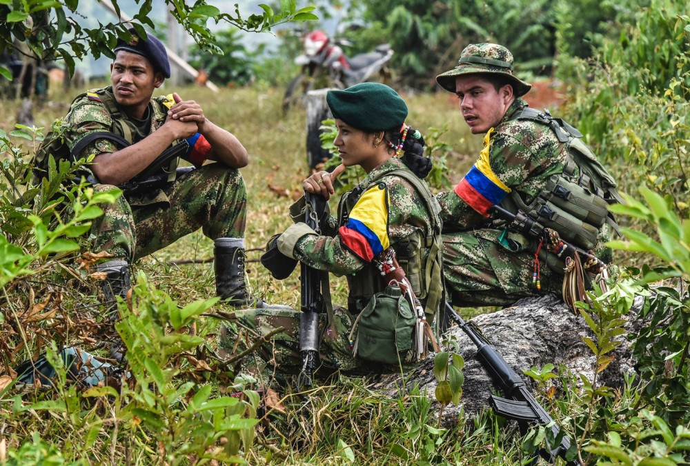 Revolutionary Armed Forces of Colombia (FARC) members rest at a camp in the Magdalena Medio region, Antioquia department, Colombia on February 18, 2016. FARC leader Timoleon Jimenez confirmed that his men were attacked by the Colombian army as they went to received one of the commanders who takes part in the Havana peace talks, who was going to inform them about the situation of the negotiations. The Marxist guerrillas have been observing a unilateral ceasefire since July. But while the government has stopped bombing FARC positions, it has yet to accede to the rebels' demand for a bilateral ceasefire. AFP PHOTO / LUIS ACOSTA / AFP / LUIS ACOSTA        (Photo credit should read LUIS ACOSTA/AFP/Getty Images)