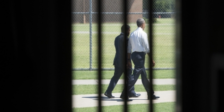 US President Barack Obama walks through the prison yard during a tour of the El Reno Federal Correctional Institution in El Reno, Oklahoma, July 16, 2015. Obama is the first sitting US President to visit a federal prison, in a push to reform one of the most expensive and crowded prison systems in the world. AFP PHOTO / SAUL LOEB        (Photo credit should read SAUL LOEB/AFP/Getty Images)