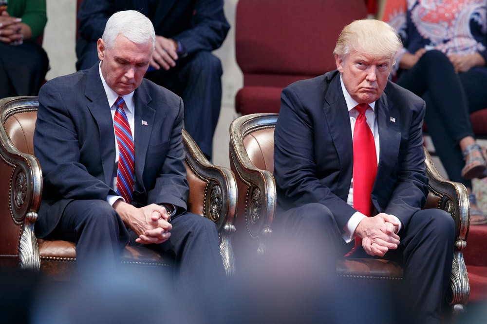 Republican presidential candidate Donald Trump and Republican vice presidential candidate, Indiana Gov. Mike Pence pause during an event at the Pastors Leadership Conference at New Spirit Revival Center, Wednesday, Sept. 21, 2016, in Cleveland, Ohio. (AP Photo/ Evan Vucci)