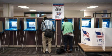Joseph and Maria Caruso vote inside the Early Vote Center in downtown Minneapolis, Minnesota after work on October 5, 2016.Voters in Minnesota can submit their ballot for the General Election at locations across the state every day until Election Day on November 8, 2016. / AFP / STEPHEN MATUREN (Photo credit should read STEPHEN MATUREN/AFP/Getty Images)