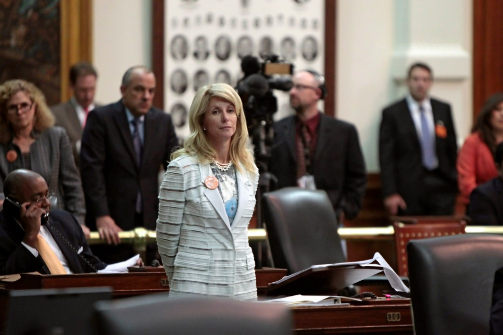 AUSTIN, TX - JUNE 25: State Sen. Wendy Davis (D-Ft. Worth) stands after the Democrats defeated the anti-abortion bill SB5, which was up for a vote on the last day of the legislative special session June 25, 2013 in Austin, Texas. A combination of Sen. Davis' 13-hour filibuster and protests by reproductive rights advocates helped to ultimately defeat the controversial abortion legislation at midnight. (Photo by Erich Schlegel/Getty Images)