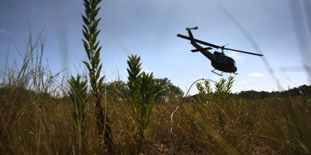 FALFURRIAS, TX - AUGUST 06:  A U.S. Office of Air and Marine helicopter searches for undocumented immigrants north of the U.S.-Mexico border on August 6, 2015 near Falfurrias, Texas. Border security and illegal immigration are expected to be major issues in the U.S. Presidential debates.  (Photo by John Moore/Getty Images)