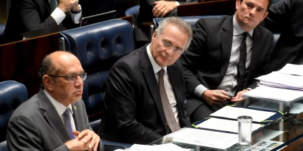 Supreme Court's Judge Gilmar Mendes (L), Senate's President Renan Calheiros (C) and Federal Judge Sergio Moro attend a public hearing on the bill that establishes the abuse of authority for judges and prosecutors, in the Senate in Brasilia on December 1, 2016.Even with a strong reaction against the bill from the public, Calheiros tries to speed up approval in the Senate and Lower House. The controversial law is ostensibly meant to crack down on undeclared election campaign funds, a common practice in Brazilian politics that has been linked to large-scale corruption. Judges and prosecutors have branded this as a weapon to reduce the judiciary's independence. / AFP / EVARISTO SA (Photo credit should read EVARISTO SA/AFP/Getty Images)