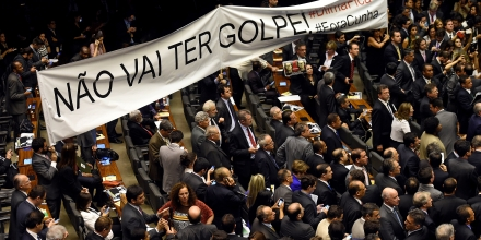 Brazilian pro-government deputies hold a banner reading