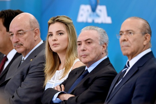 Brazilian First Lady Marcela Temer (2-L), Brazilian President Michel Temer (2-R), Chief of Staff Eliseu Padilha (R) and Minister of Social Development Osmar Terra attend the launching ceremony of the Happy Child Programme at Planalto Palace in Brasilia, Brazil, on October 5, 2016. / AFP / EVARISTO SA        (Photo credit should read EVARISTO SA/AFP/Getty Images)