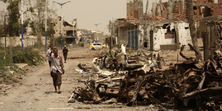 A Yemeni man walks past cars destroyed during fighting with al-Qaida militants in the city of Zinjibar, Yemen, Thursday, June 14, 2012. Airstrikes and clashes intensified in southern Yemen on Wednesday as army troops followed major victories with more pressure on al-Qaida militants holding small towns, according to tribal and military officials. The attacks came a day after Yemeni forces regained control of two major al-Qaida strongholds, Jaar and Zinjibar, which were in the hands of the militants for more than a year. (AP Photo/Hani Mohammed)