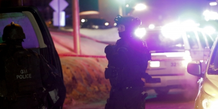 Police survey the scene after a deadly shooting at a mosque in Quebec City, Canada, Sunday, Jan. 29, 2017. Quebec Premier Philippe Couillard termed the act