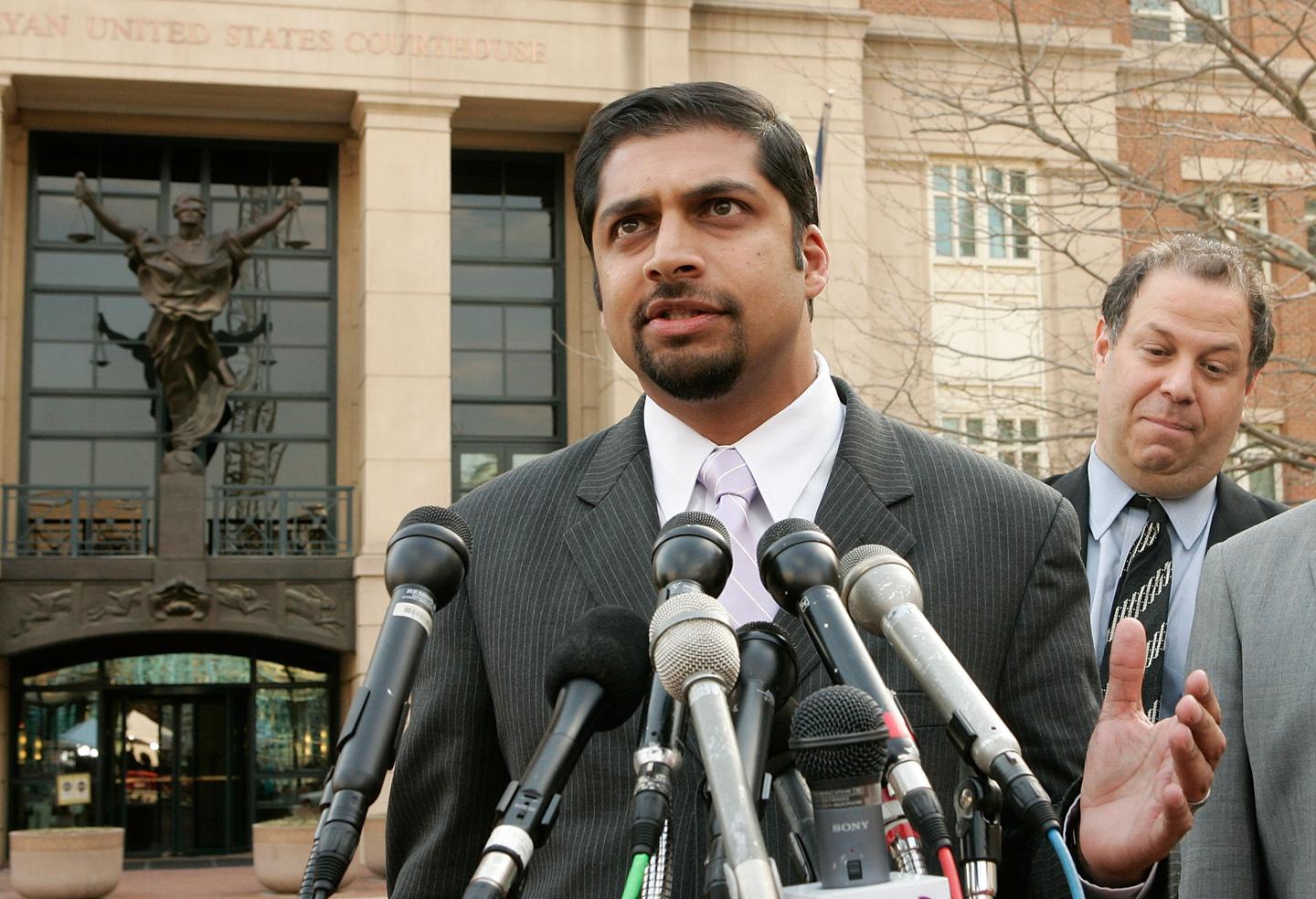ALEXANDRIA, VA - MARCH 29:  Defense attorney Khurrum Wahid (L) of Ahmed Omar Abu Ali answer questions from the media as defense attorney Joshua Draetel (R) listens after Abu Ali was sentenced to 30 years in prison for joining al-Qaeda and conspiracy to assassinate U.S. President George W. Bush at a federal court March 29, 2006 in Alexandria, VA. Attorneys of Abu Ali said they will appeal for the case.  (Photo by Alex Wong/Getty Images)