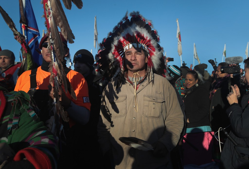 CANNON BALL, ND - DECEMBER 04:  Native American and other activists celebrate after learning an easement had been denied for the Dakota Access Pipeline at Oceti Sakowin Camp on the edge of the Standing Rock Sioux Reservation on December 4, 2016 outside Cannon Ball, North Dakota. The US Army Corps of Engineers announced today that it will not grant an easement to the Dakota Access Pipeline to cross under a lake on the Sioux Tribes Standing Rock reservation, ending a  months-long standoff.  (Photo by Scott Olson/Getty Images)