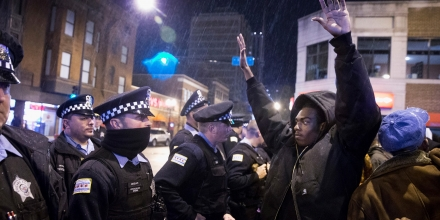 CHICAGO, IL - NOVEMBER 25:  Demonstrators confront police during a protest over the death of Laquan McDonald on November 25, 2015 in Chicago, Illinois. Small and mostly peaceful protests have sprouted up around the city following yesterday's release of a video showing Chicago Police officer Jason Van Dyke shooting and killing 17-year-old McDonald. Van Dyke has been charged with first degree murder for the October 20, 2014 shooting in which McDonald was hit with 16 bullets.  (Photo by Scott Olson/Getty Images)