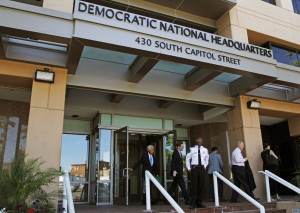 FILE - In this June 14, 2016 file photo, people stand outside the Democratic National Committee (DNC) headquarters in Washington. The computers of the House Democratic campaign committee have been hacked, an intrusion that investigators say resembles the recent cyber breach of the Democratic National Committee for which the Russian government is the leading suspect. (AP Photo/Paul Holston, File)