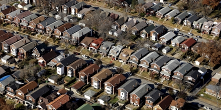 Rows of modest houses are seen in Jennings, Mo. in this aerial photo taken Tuesday, Nov. 25, 2014. (AP Photo/Charlie Riedel)