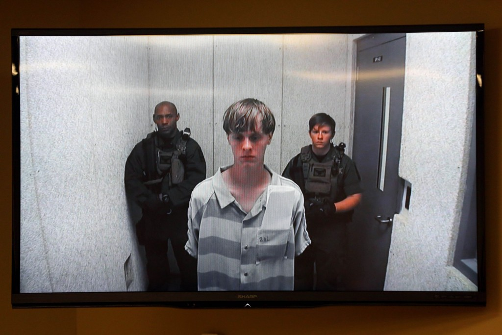 FOR USE AS DESIRED, YEAR END PHOTOS - FILE - Dylann Roof appears at a bond hearing court in North Charleston, S.C., June 19, 2015. Roof is accused of killing nine people inside Emanuel African Methodist Episcopal Church in Charleston on June 17. (Grace Beahm/The Post And Courier via AP, POOL, File)