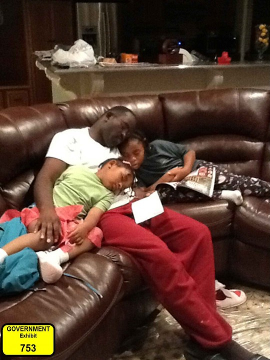 Government Exhibit 753, in the trial of Dylann Roof, shows Clementa C. Pinckney, a prominent minister and state senator, asleep on the couch with his daughters Eliana and Malana.