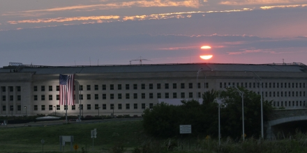 ARLINGTON, VA - SEPTEMBER 11: In this U.S. Navy handout, sunrise at the Pentagon prior to a ceremony to commemorate the 15th anniversary of the Sept. 11, 2001 terror attacks. The American flag is draped over the site of impact at the Pentagon.  In 2008, the National 9/11 Pentagon Memorial opened  adjacent to the site, located on Boundary Channel Drive in Arlington, Va., and commemorates the 184 lives lost at the Pentagon and onboard American Airlines Flight 77 during the terrorist attacks. (Photo by Damon J. Moritz/Released via Getty Images)