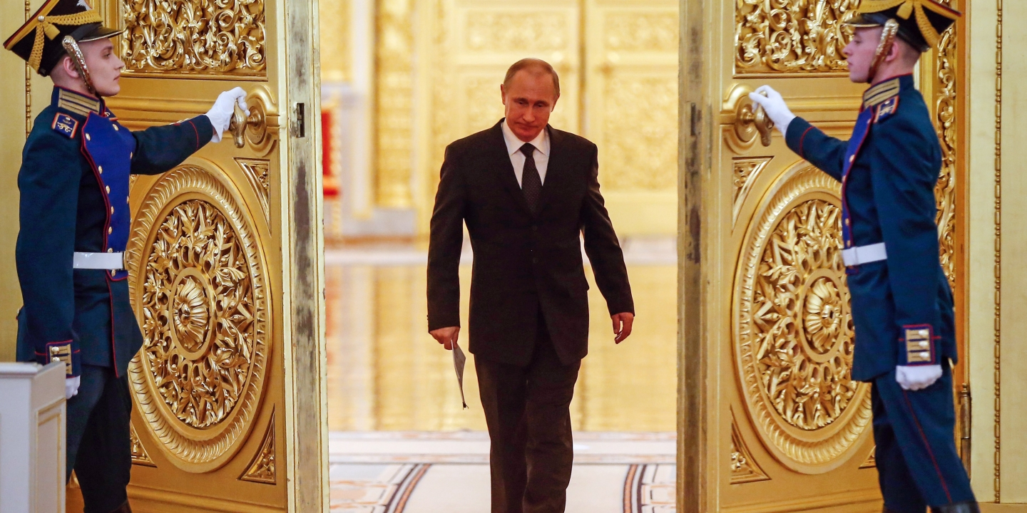 Russian President Vladimir Putin enters a hall before a meeting of the Victory Organizing Committee at the Kremlin in Moscow on March 17, 2015. The meeting focuses on preparations for celebrating the 70th anniversary of the victory in World War II. / AFP / POOL / SERGEI ILNITSKY (Photo credit should read SERGEI ILNITSKY/AFP/Getty Images)