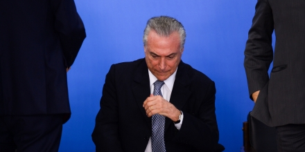 TOPSHOT - Brazilian acting President Michel Temer attends a meeting with business leaders next to his Finance Minister Henrique Meirelles (out of frame) at Planalto Palace in Brasilia, June 8, 2016.Brazil's annual inflation rate crept up last month to 9.32 percent, officials said Wednesday, sounding new alarm bells for Latin America's largest economy as it struggles through a deep recession. The stubbornly high inflation rate had been looking somewhat better recently, falling in each of the past three months, to 9.28 percent in April. / AFP / ANDRESSA ANHOLETE (Photo credit should read ANDRESSA ANHOLETE/AFP/Getty Images)
