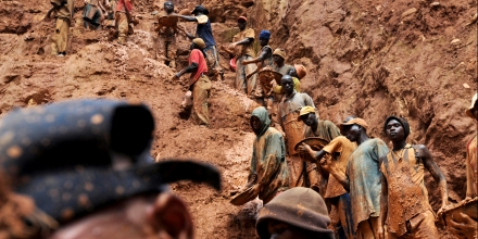 (FILES) This photo taken February 23, 2009 shows mining workers standing on a muddy cliff as they work at a gold mine in Chudja, near Bunia, north eastern Congo. Eighteen prospectors were killed overnight on August 19-20, 2009 in a diamond mine in central Democratic Republic of Congo, union officials said on August 20, 2009. Celestin Kubela, the head of the local mining authority in Kasai province, said that the victims, who were all illlegal miners, are thought to have touched a power cable deep underground. AFP PHOTO / LIONEL HEALING (Photo credit should read LIONEL HEALING/AFP/Getty Images)