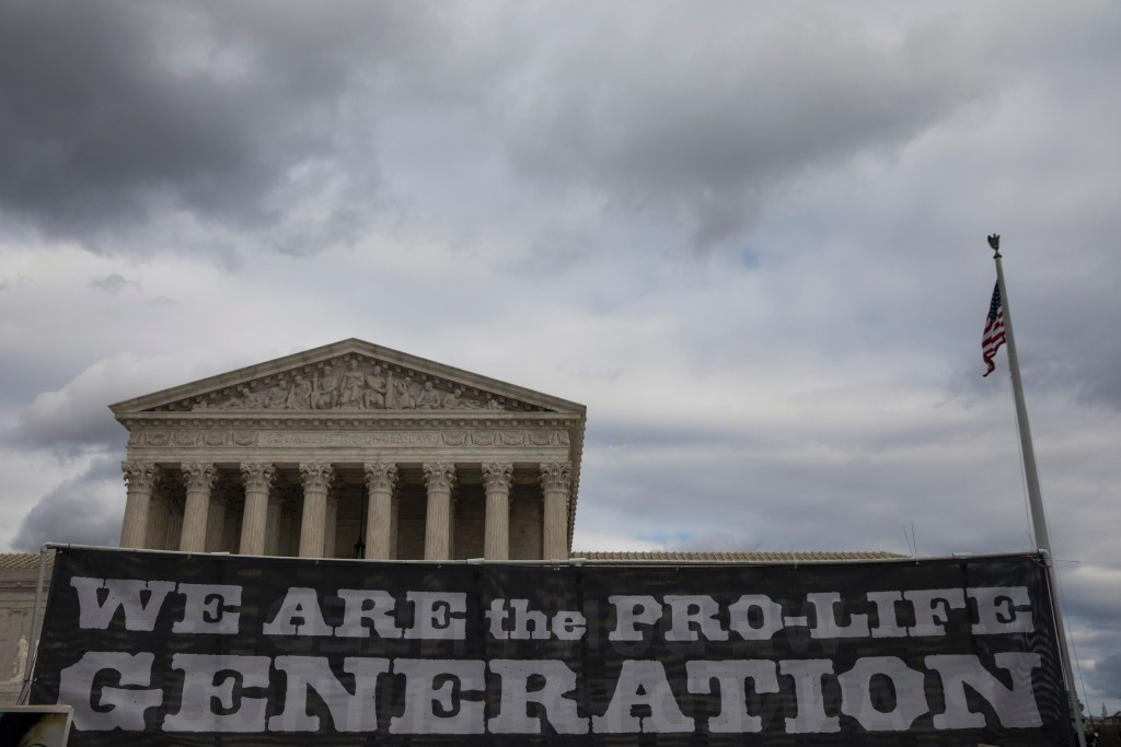 Pro-life demonstrators protest in front of the US Supreme Court during the 44th annual March for Life in Washington, DC, on January 27, 2017.<br /><br /><br /><br /><br /><br /> Anti-abortion advocates descended on the US capital on Friday for an annual march expected to draw the largest crowd in years, with the White House spotlighting the cause and throwing its weight behind the campaign. / AFP / ZACH GIBSON        (Photo credit should read ZACH GIBSON/AFP/Getty Images)