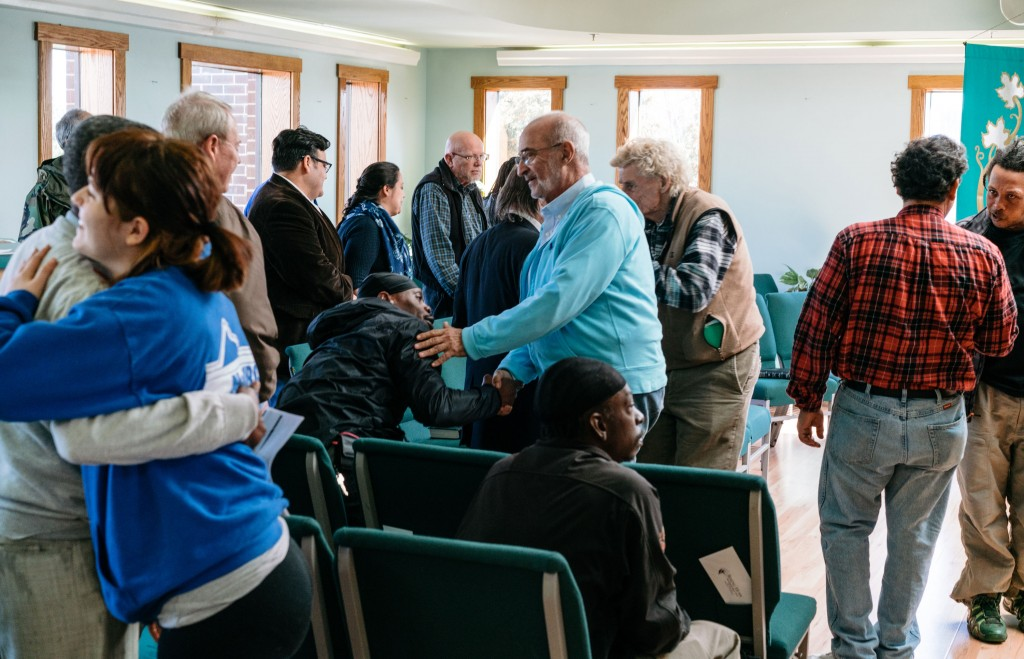 Members of Rising Hope Mission Church in Alexandria, Va. wish peace upon one another on Feb. 26, 2017. Recently, six men allegedly leaving the cold weather shelter at the church were stopped by ICE and handcuffed and detained.