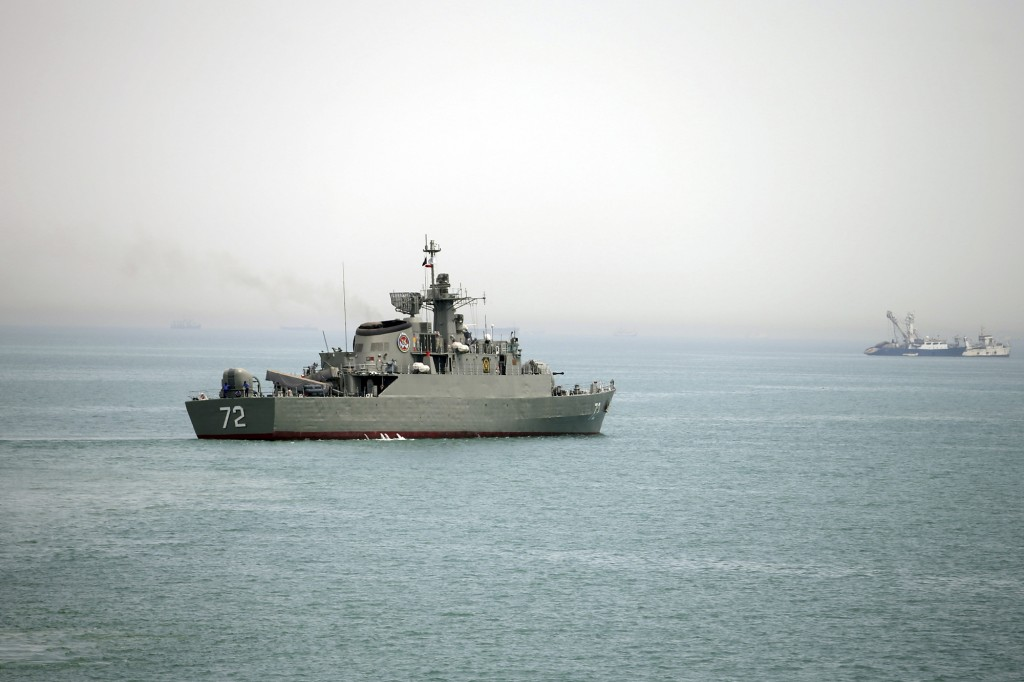 "In this picture taken on Tuesday, April 7, 2015, and released by the semi-official Fars News Agency, Iranian warship Alborz, foreground, prepares before leaving Iran's waters, at the Strait of Hormuz. Iran dispatched a naval destroyer and another vessel Wednesday to waters near Yemen as the United States quickened weapons supply to the Saudi-led coalition striking rebels there, underlining how foreign powers are deepening their involvement in the conflict. Iran's English-language state broadcaster Press TV quoted Rear Adm. Habibollah Sayyari as saying the ships would be part of an anti-piracy campaign ""safeguarding naval routes for vessels in the region."" (AP Photo/Fars News Agency, Mahdi Marizad)"