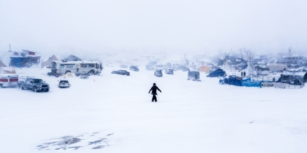 Winter has arrived in Standing Rock at the Oceti Sakowin Camp in North Dakota, the day after the Army Corps of Engineers denied the easement needed to build the pipeline on December 5, 2016. Despite driving snow and 40-plus mile an hour wind a group of 700-plus veterans and water protectors marched toward the barricade on highway 1806. (Photo by Michael Nigro / Pacific Press) *** Please Use Credit from Credit Field ***(Sipa via AP Images)