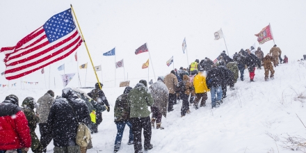 DECEMBER 5, 2016 - NEAR CANNON BALL, ND: Self-titled Water Protectors march the day after the announcement by the Army Corps of Engineers that they would deny the easement for the pipeline nearby. The camp of Native Americans and other activists hosted thousands of veterans from around the country protesting the Dakota Access Pipeline that is being built nearby.