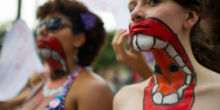 Women with their upper bodies painted pose as they take part in a protest against violence against women during the celebration of the International Women's Day on March 8, 2013, in Sao Paulo, Brazil. AFP PHOTO/YASUYOSHI CHIBA        (Photo credit should read YASUYOSHI CHIBA/AFP/Getty Images)