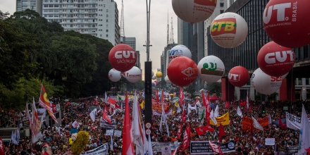 SAO PAULO, BRAZIL - MARCH 15: People protest against the pension reform proposed by President Michel Temer's government on March 15, 2017 in Sao Paulo, Brazil. Thousands of teachers, drivers from the transport system, bankers and various unions gathered on Avenida Paulista during a nationwide strike to protest the increase in time people must work before retirement. (Photo by Victor Moriyama/Getty Images)