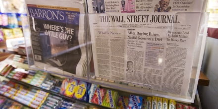 Barron's and The Wall Street Journal, both owned by Dow Jones, are shown, Monday, July 23, 2007 at a New York newsstand. Bancroft family members, who own controlling interest in Dow Jones, are meeting in Boston Monday to decide if they will accept News Corp's offer for Dow Jones. (AP Photo/Mark Lennihan)